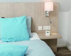 Das Homematic IP Thermostat kann frei stehend positioniert oder an einer Wand befestigt werden